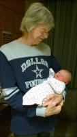 my husband with our newest grandbaby